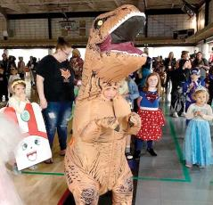 Briggs Pusch of Cashiers potrays a T-rex dinosaur at Goblins in the Green Friday. He was named Best Boy (6-10) for the get-up. (Photo by Nancy Warriner.)