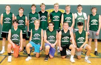 This year's Blue Ridge Early College boys basketball team includes, front, from left, Derrick Bryson, Korbin Walters, Carsen Williams, Kaleb Fugate, Caleb Bedient; and back, same order, Steven Madden, Jacob Pressler, Colton Taylor, Johnny Jennings, Carsen Druffell, Collin Bryson, Devin Bryson and Joe Madden. C.J. Jennings was unavailable for the photo. (Photo by Dan Brown.)