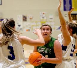 Junior Maddie Potts drives for two against Hiwassee Dam in the LSMC tournament.