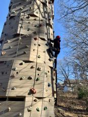 Mo Blackburn takes the first climb on Summit Charter School's new rock climbing tower on the school's campus.