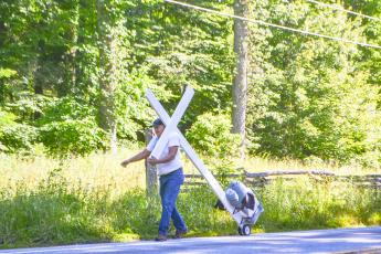 Roger Gates is walking coast-to-coast with a wooden cross to raise money for his ministry.