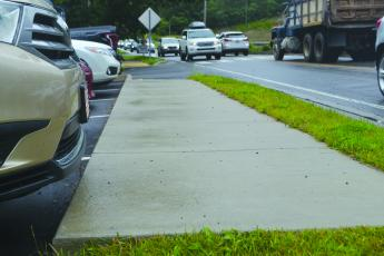 The new sidewalk extending down Highway 64 near Randevu is just one of many community projects being undertaken by Vision Cashiers this year.