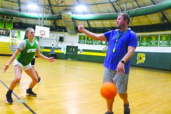 Blue Ridge Lady Bobcats Coach Tim Mayse working with standout senior Charlotte Sherrill in pre-season workouts last fall. Mayse will also coach the BREC boys basketball team this year.