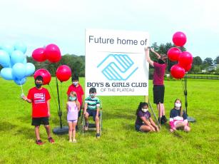 Boys & Girls Club of the Plateau members set up a tent on the property of its proposed new facility to show the community its plans for the future.