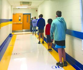 Students line up six feet apart for testing during a recent free testing event at Highlands School, sponsored by the Highlands Cashiers Health Foundation.