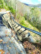 Rainfall has destroyed much of the roadway on one of the switchbacks along Cedar Creek Road.