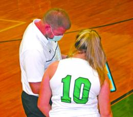 Blue Ridge coach Tim Mayse reviews a play with Blue Ridge Sophomore Macy Heltsley.