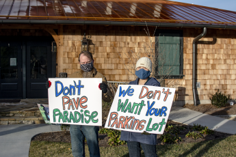 Protestors gathered once again outside the Village Green on Jan. 6, after the initial pushback against the Hillside development at a November meeting of the Cashiers Area Community Planning Council contributed to a postponement of the hearing.