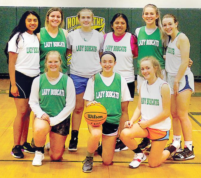 This year's Blue Ridge Early College girls basketball team includes, front, from left, Kaitlyn Stewart, Mahalah Stewart, Mercedes McLaughlin; and back, same order, Gabby Martinez, Madeline Potts, Macy Heltsley, Brenda Martinez, Charlotte Sherrill and Chloe Fowler. (Photo by Dan Brown.)