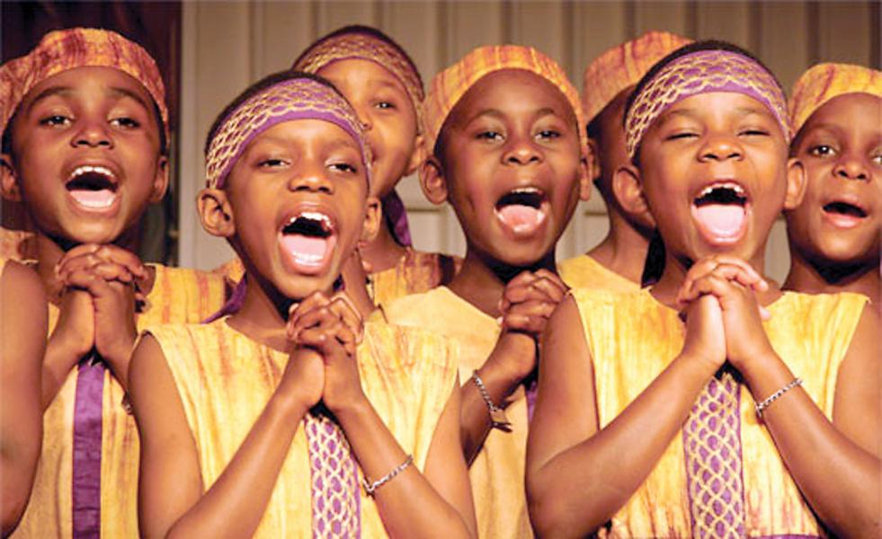 Members of the African Children's Choir sing a lively African song. The children also perform African dances.