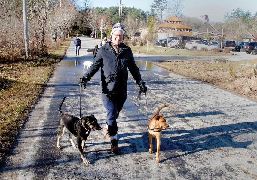 "Scott Fridkin of Sapphire exits Frank Allen Road's ""Cashiers Car Wash"" with his pooches Ziggy and Scoobee (Photo by Don Richeson.)"