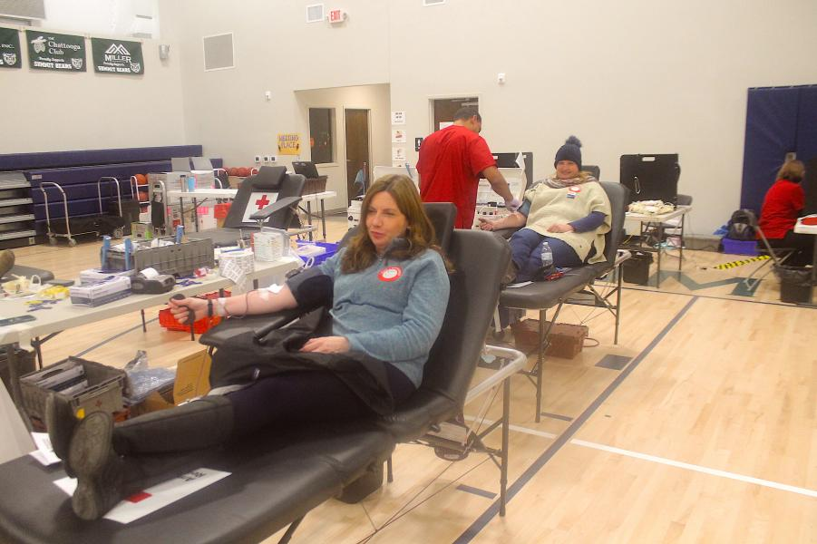 Cashiers residents Erica Sherrill (front) and Hannah Moody (back) donate blood for Summit Charter School's second annual blood drive on Friday.