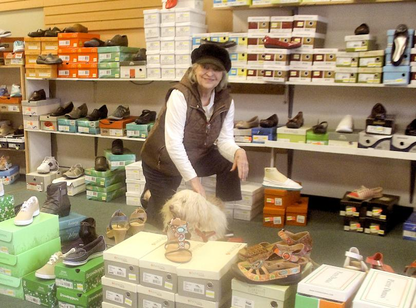 Melba McCall, along with her store mascot, Sunshine, a 15-year-old Tibetan terrier has closed her shoe store Footprints Shoes after 37 years in business.
