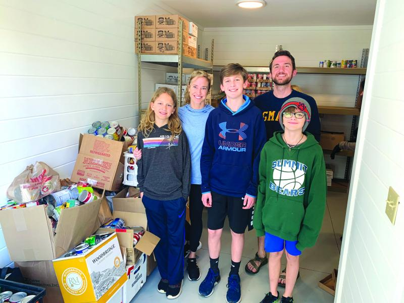 Summit Charter School Middle School Student Council delivered 1,600 canned goods to the Fishes and Loaves Food Pantry before school closed. From left are Samuel Dyer, Rachel Dyer, Oliver Dyer, Jesse Loyd and Townsend Dyer.