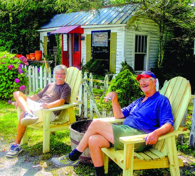 "Longtime friend Al Akers and Wormy Chestnut owner Phil ""Slick"" Montieth enjoy a leisurely afternoon as the days until Sept. 1 wind down. The Wormy Chestnut will close its doors to make way for future retail development."