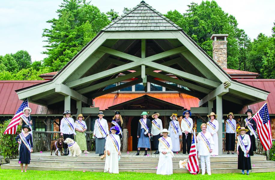 Seventeen women gathered at the Village Green in Cashiers prior to the 100th anniversary of the passage of the 19th amendment, dressed in full period garb, to commemorate the monumentous occasion. Pictured are (front row from left): Bev Seinsheimer, Susan Bianchi, Linda Benge, Ann Strub and Barbara Short; (back row from left): Ann Self, Janeann Thomas, Brook Owens, Pat Verdisco, Amy Asay, Susan Brandt, Sharon Skye, Carolyn Chabora, Ann Austin, Shug Soldo, Laura Flaherty and Eleanor Welling.